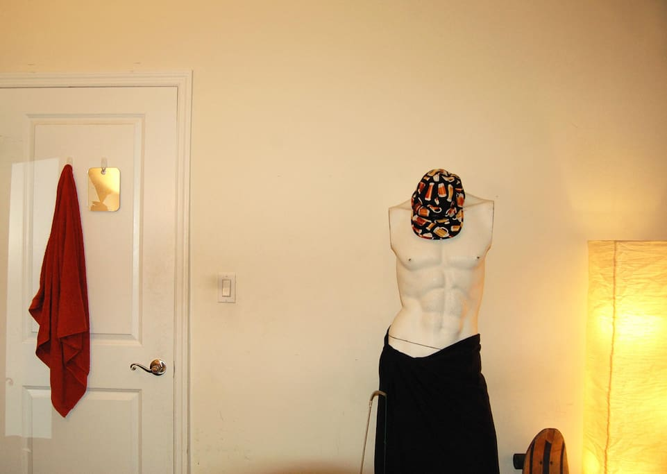 Your room comes free with a sexy mannequin/hat rack and great lighting.