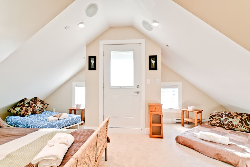 loft style bedroom sleeps 4 people, with 1 queen bed, 2 single/twin