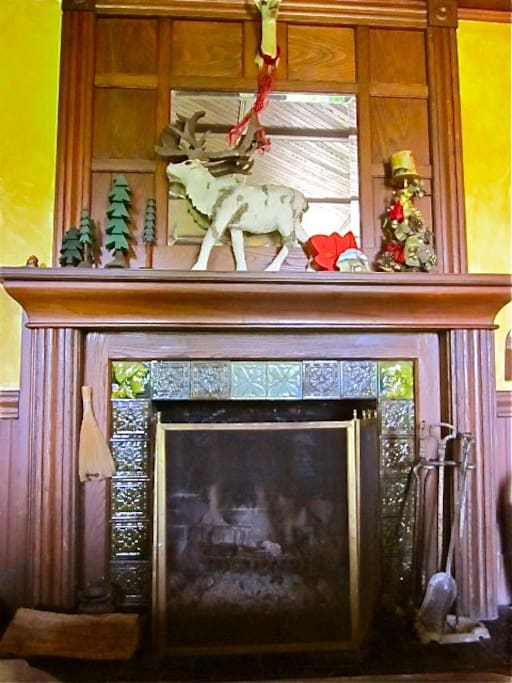 Arts and crafts fireplace adds a cozy ambiance.