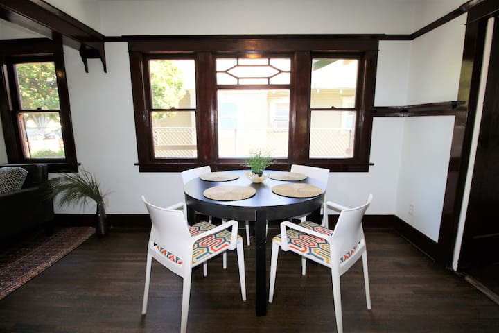 Dining area with custom maple wood work.  Oak stained original hardwood floor!