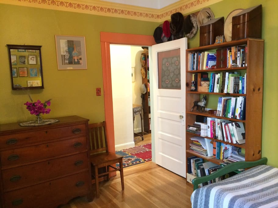 Bright, colors and personal art give this room a warm glow