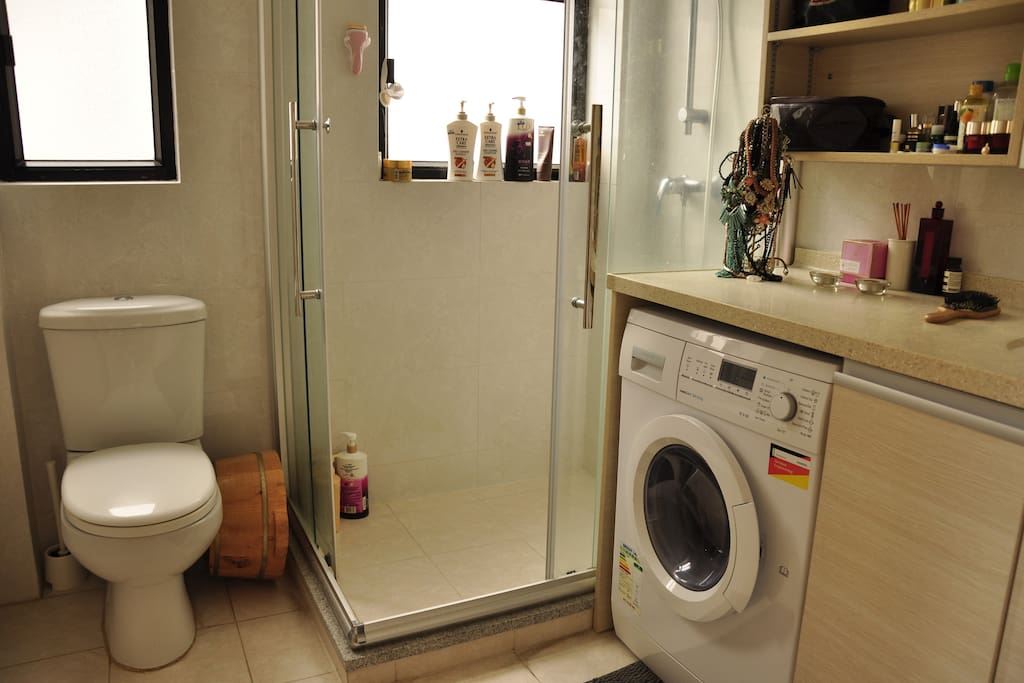 Large bathroom with washer.