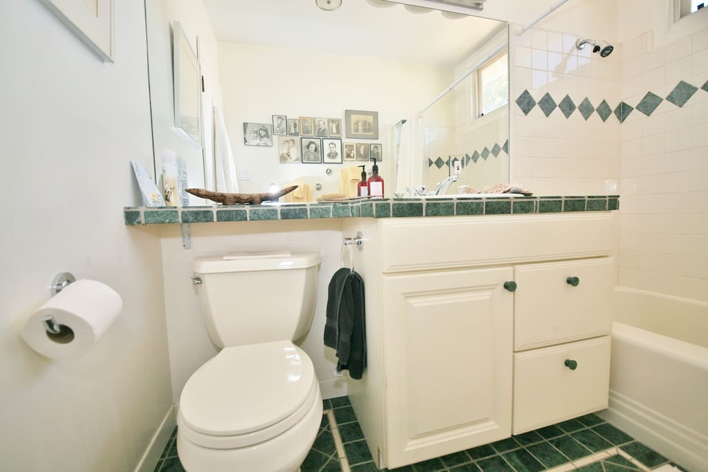 Private bathroom with tub/shower,  fresh towels and toiletries.