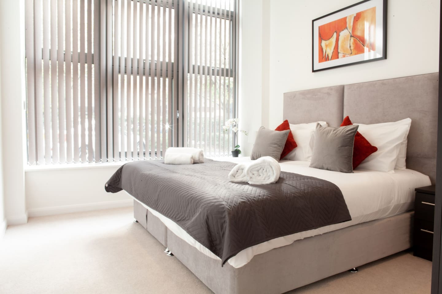 Your spacious bedroom comes with hotel quality linen and towels. Extra decorative cushions for your comfort, bedside table with a bed lamp.