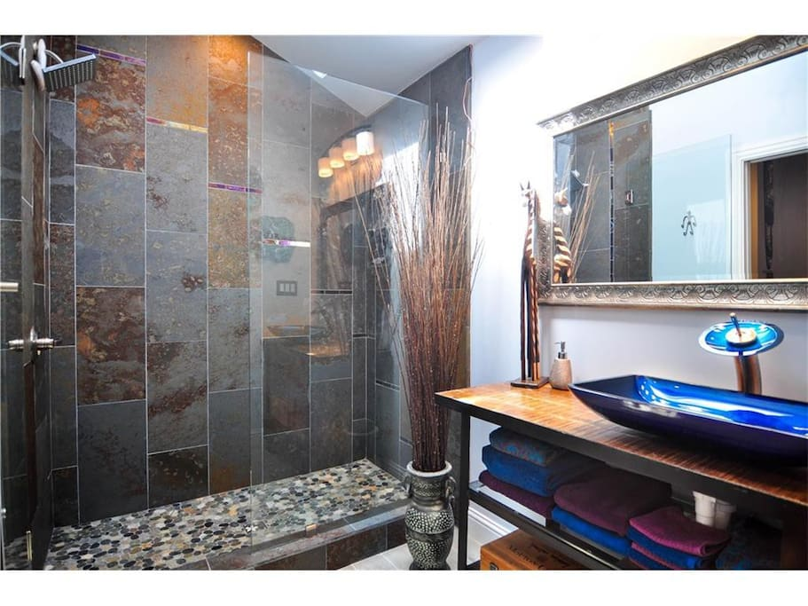 A beautiful bathroom with river rock floors, an amazing shower and tons of space!