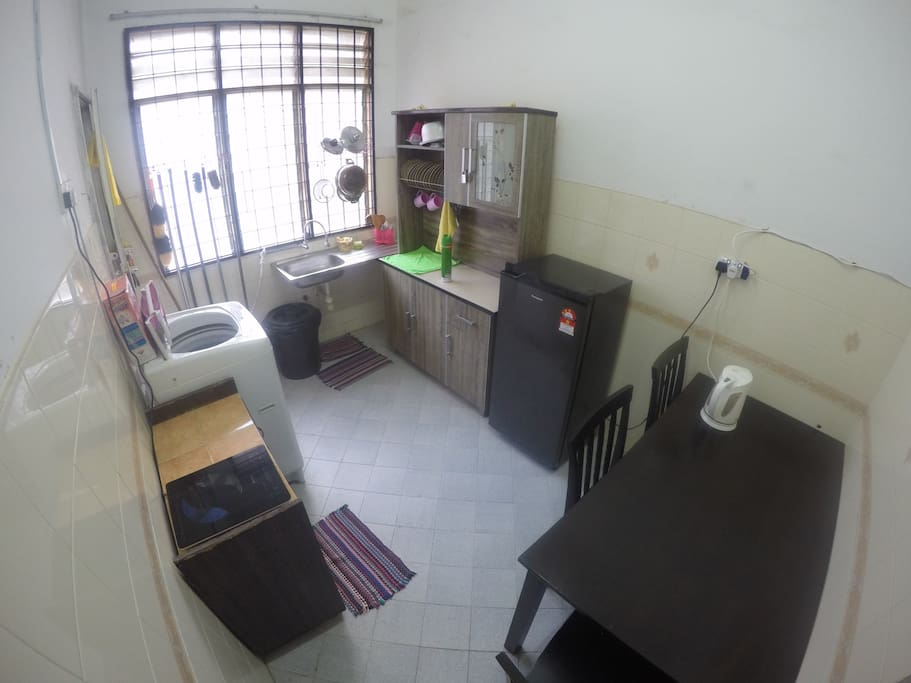 Kitchen equipped with cooking ware, refrigerator & washing mashine.