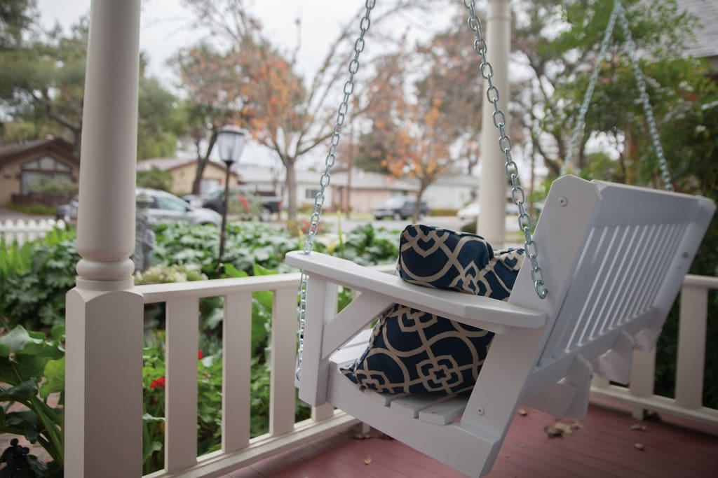 Front porch swing perfect for sipping coffee in the morning or a glass of wine in the evening