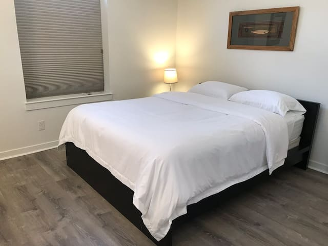 Bedroom #1 Queen size bed, memory foam mattress, large room, closet for hanging clothes, iron and ironing board as well