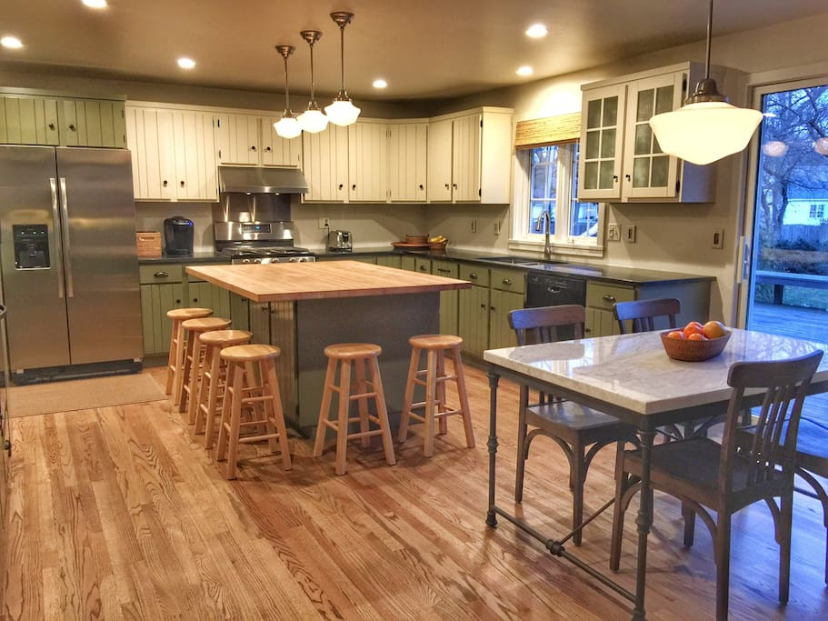 Large eat-in kitchen with dining table and center island.