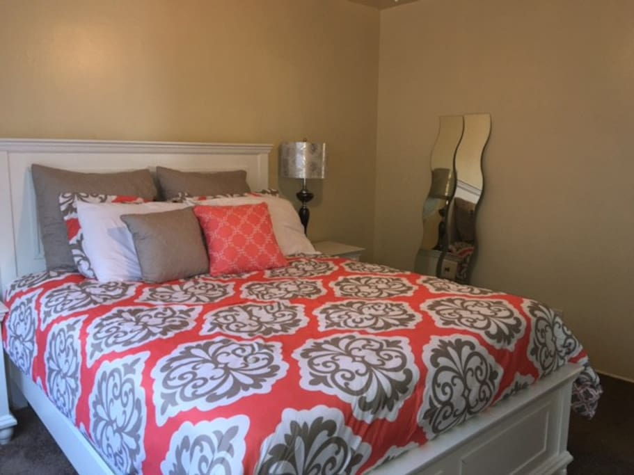 Bedroom 1, queen size bed with mirrors.  This bed has a softer mattress for those who like a softer sleep.