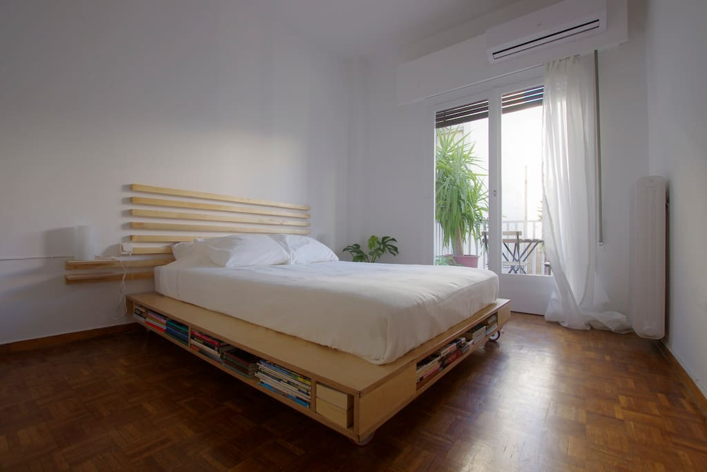 Bedroom, custom designed and built plywood bed  on scaffolding wheels