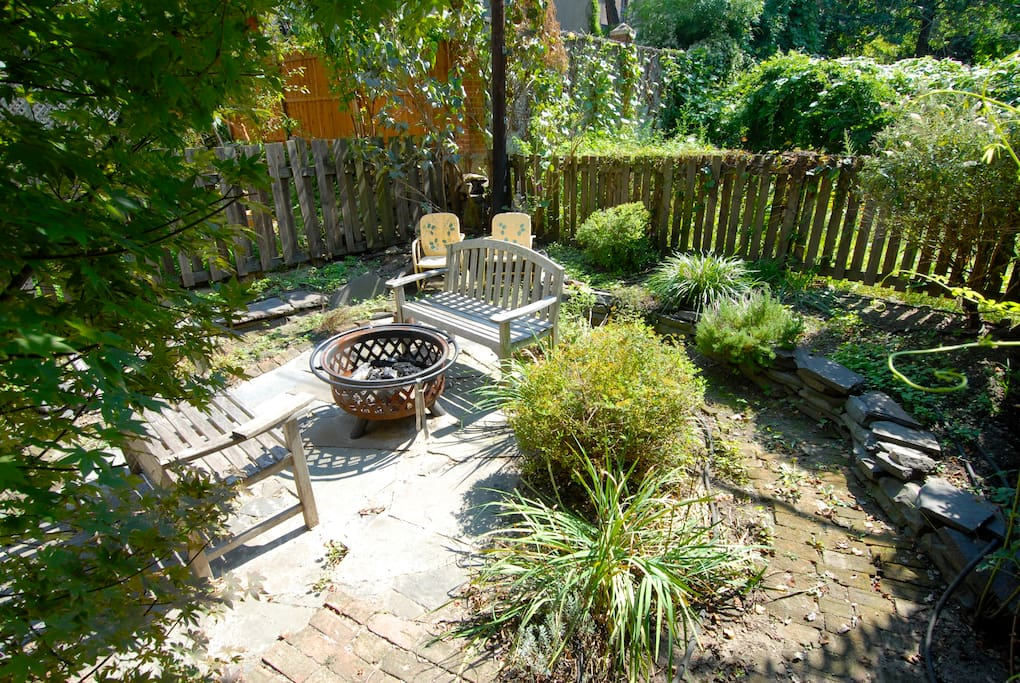 private backyard with grill and fire pit.