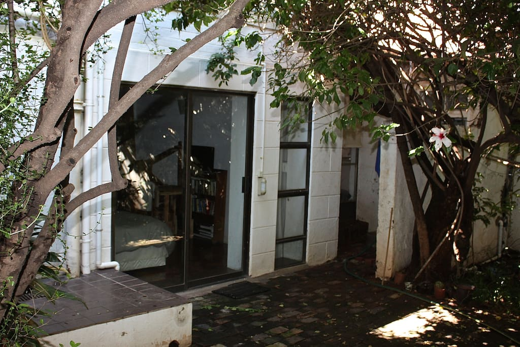 Exterior view of the garden apartment from the courtyard.