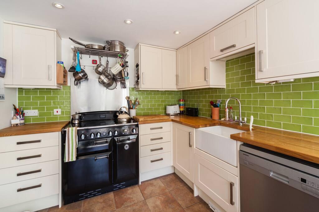 Modern kitchen with induction Rangemaster cooker.