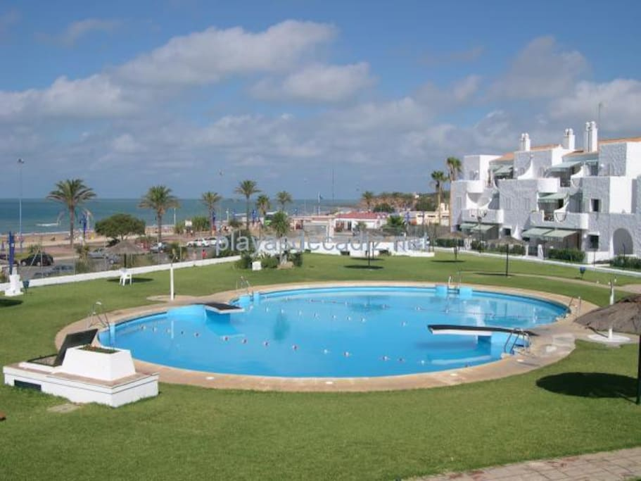 Swimming pool with springboards, children area, and sights to the sea