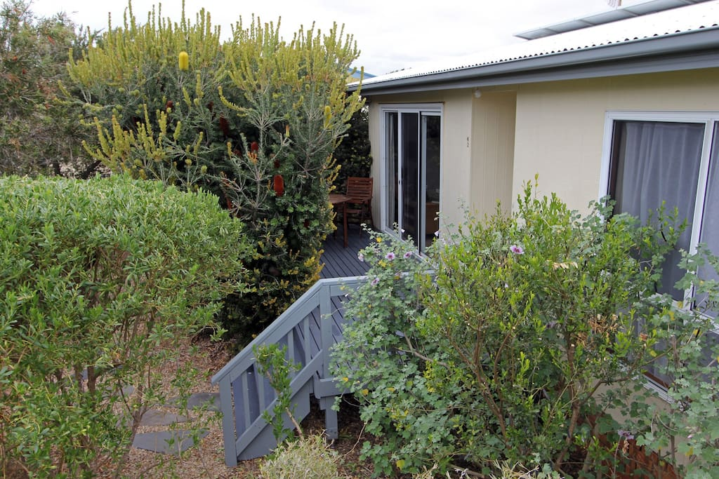 House has a relaxing front verandah with family room, and bedrooms looking out into garden.