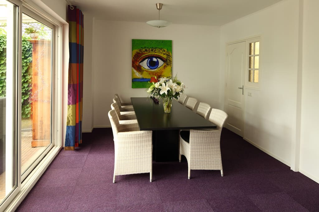 Comfortable diningroom with gardenview and floorheating. Also available for dinerparty's