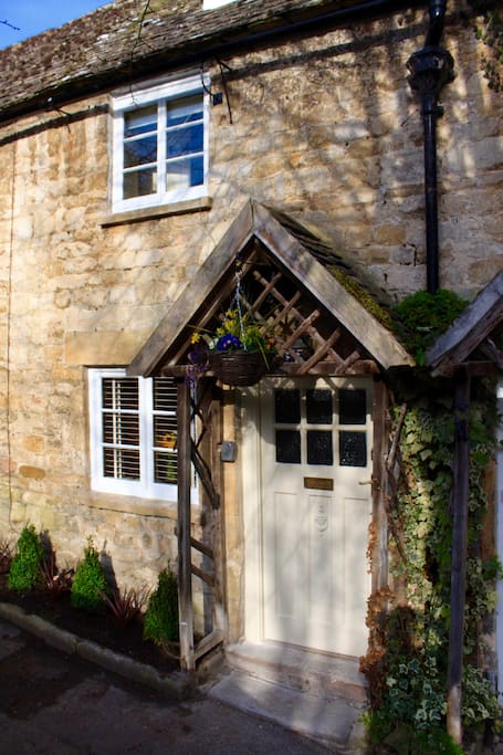 The delightful front door of the cottage right on Vineyard Street. One of the prettiest row of cottages in the Cotswolds.