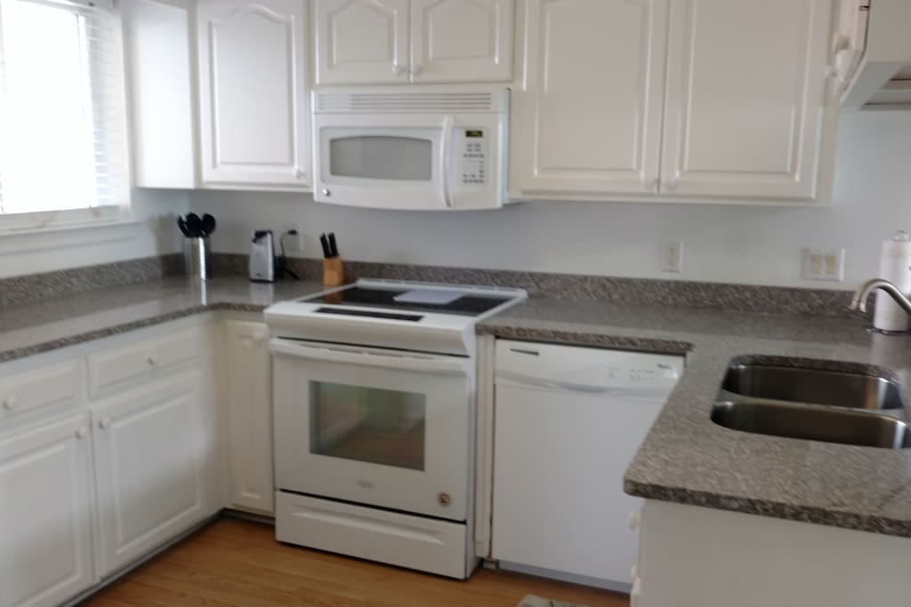 kitchen with brand new granite counter tops and new appliances
