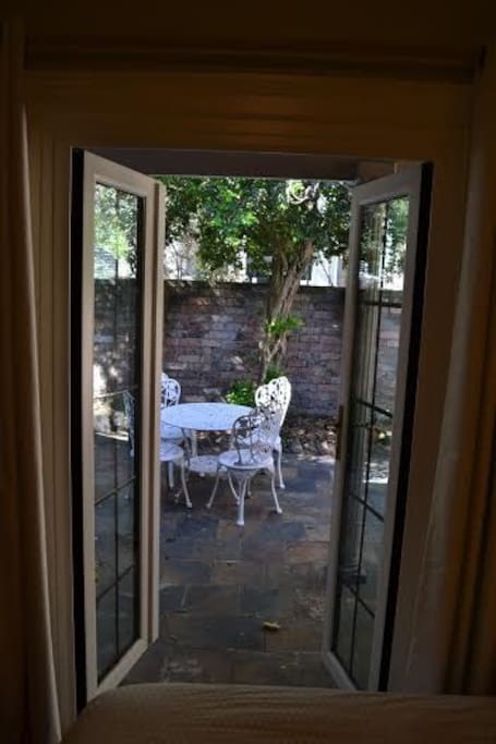 Double doors which open out onto the front courtyard
