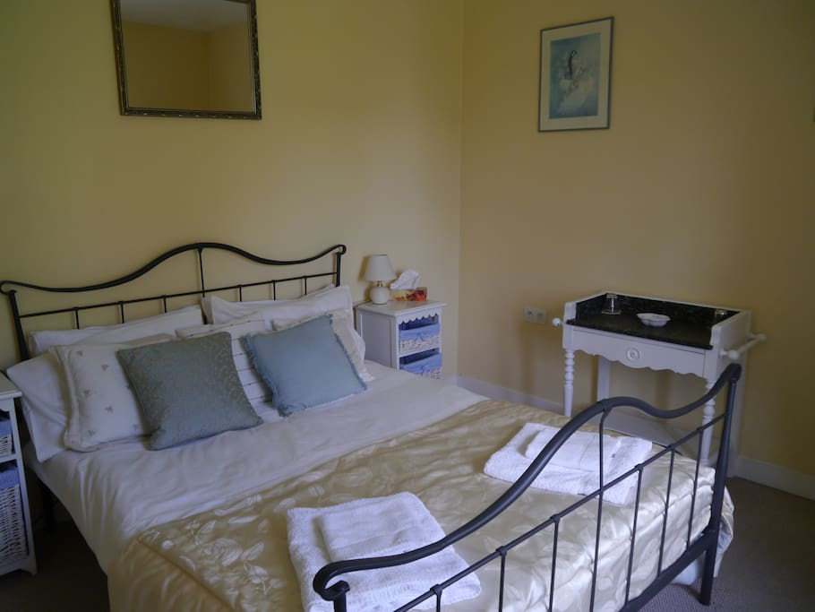 Double en-suite bedroom overlooking the orchard and back garden offering the morning sun