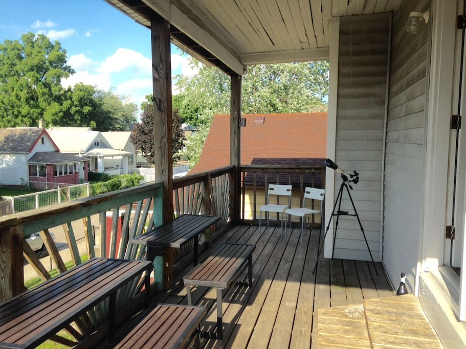 The balcony is so large, we were able to get some neat deck furniture. Use it as a table, or flip up the top to convert it to a bench!