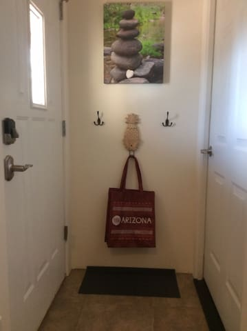 A place for shoes and jackets, also shopping bags for your use during your stay.