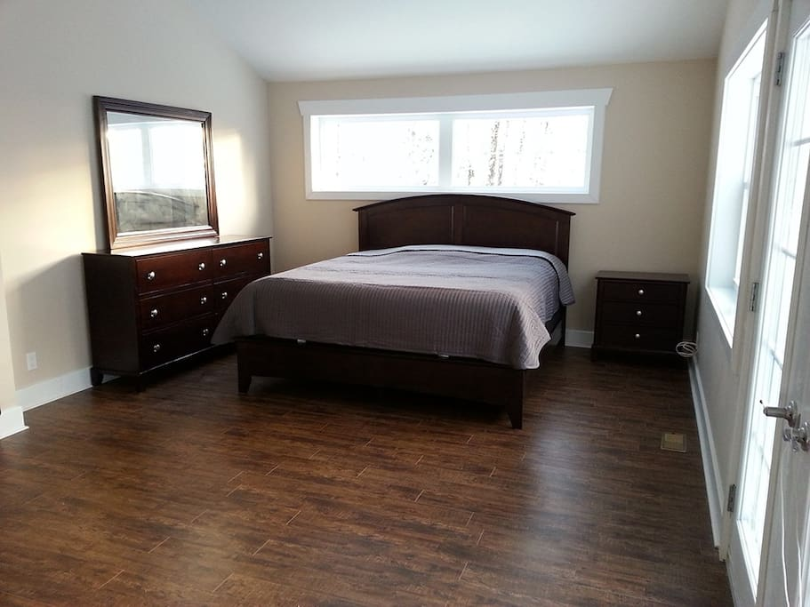 Master bedroom features king bed, patio and ensuite