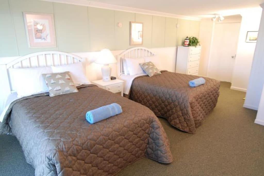 Two double beds in private, large, bedroom.