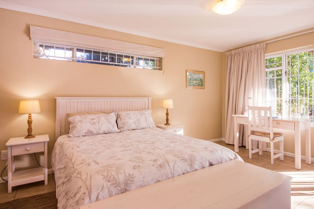 The windows above the bed open and together with regular sized windows opposite the room, ensure cross-ventilation which keeps the cottage cool in summer