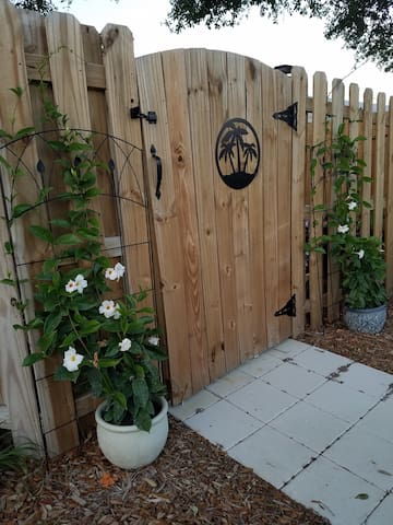 Private entrance gate that leads to your own garden patio and front door