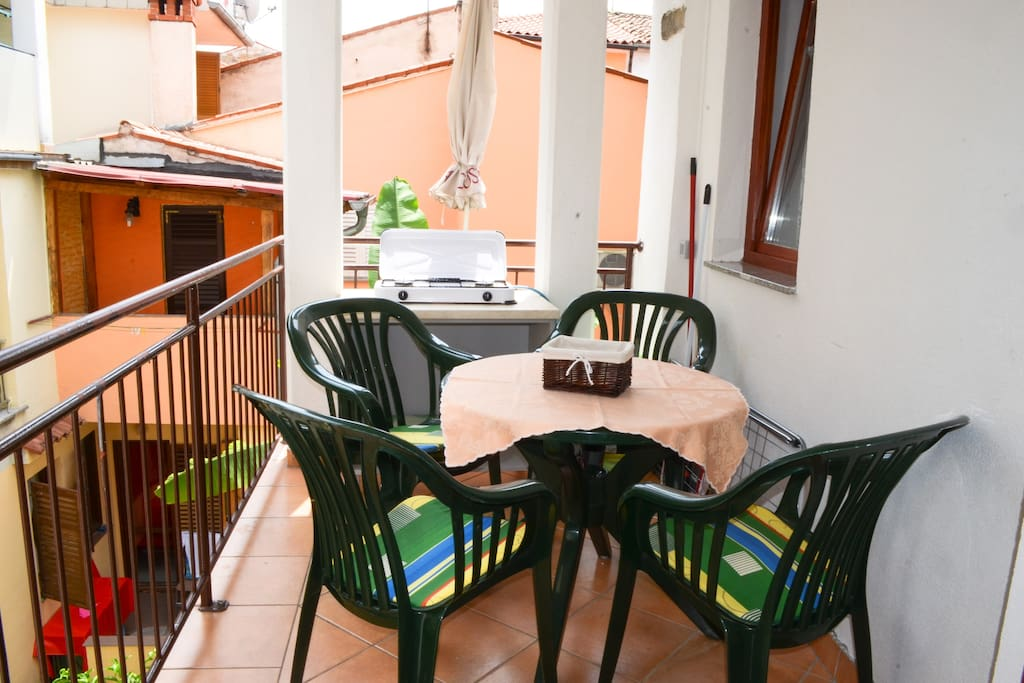 Balcony with dining area and extra gas stove