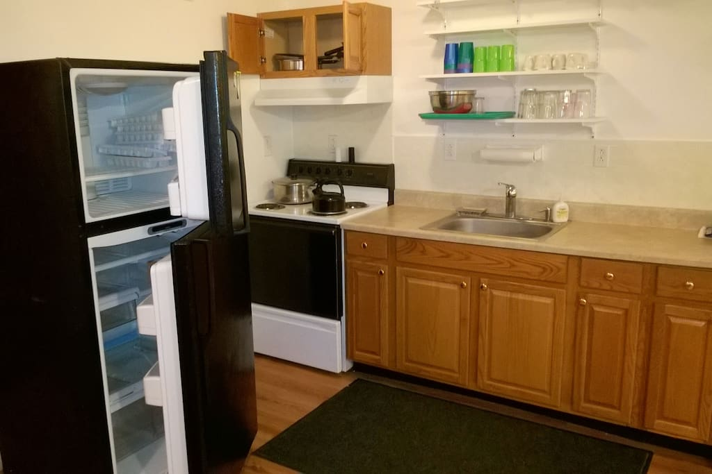 Kitchenette with good sized refrigerator/freezer.  Utensils, basic pots/pans, cups and glasses available.  Toaster, too.