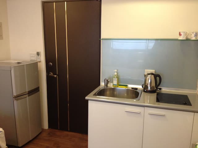 Kitchen with burner and refrigerator