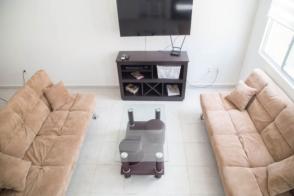 Living/Family Room: Plush sofas that fold out into beds, A/C, flat screen TV, cable, wifi