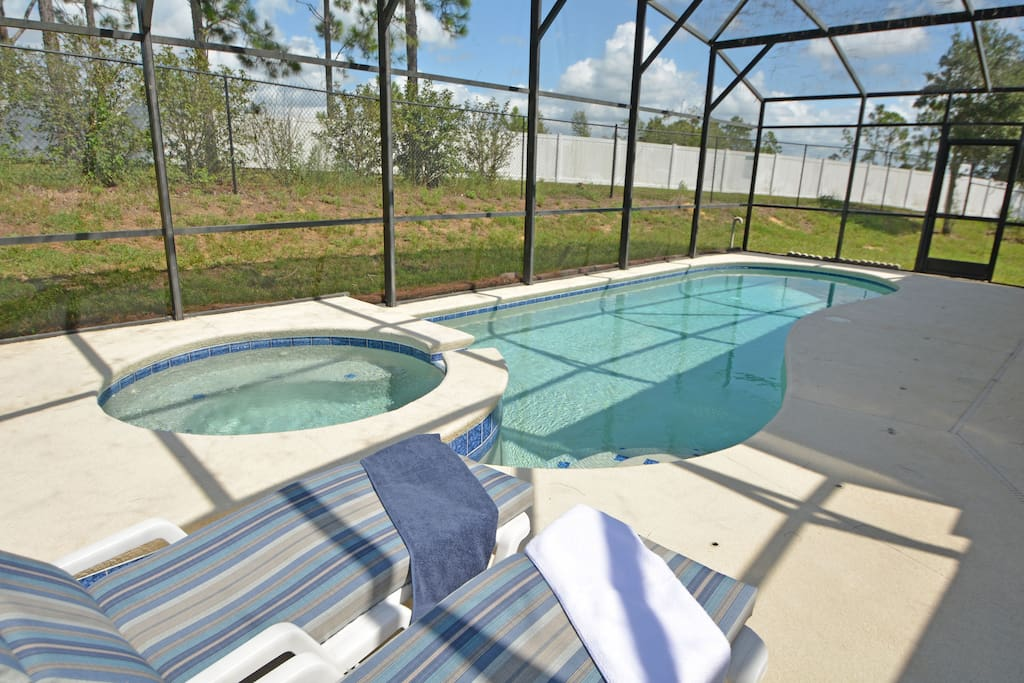 Pool and jacuzzi with sun loungers