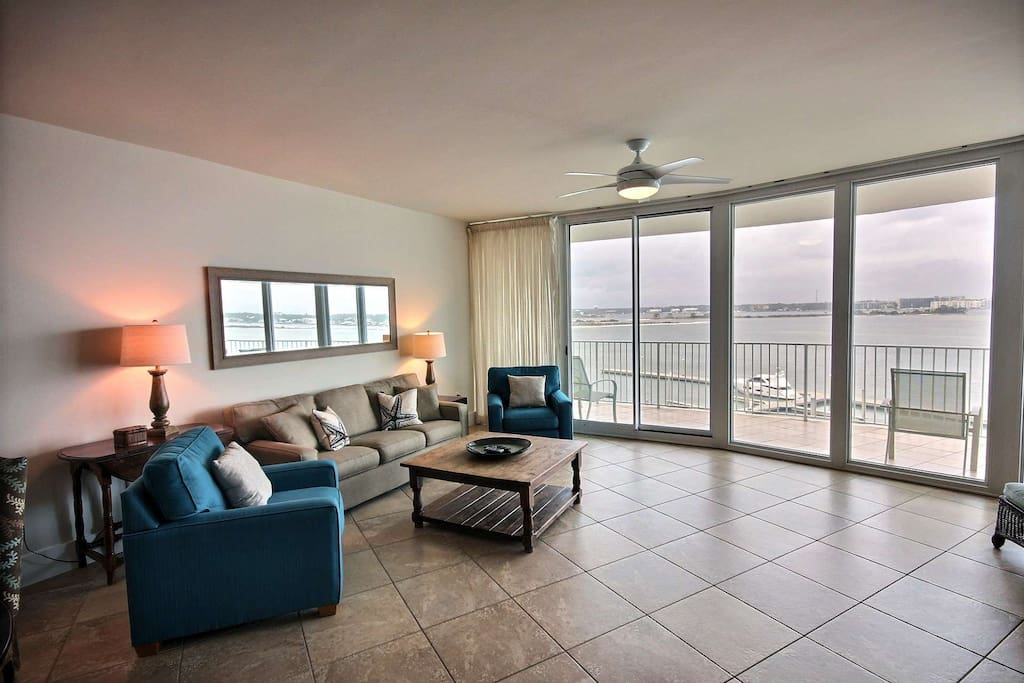 Living room with panoramic bay view and tiled patio