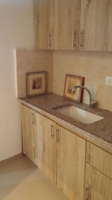Equipped with kitchen cabinets and drawers, kettle, utensils and microwave oven
