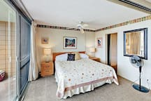 Sleep to the sound of the ocean in the master bedroom with king-sized bed