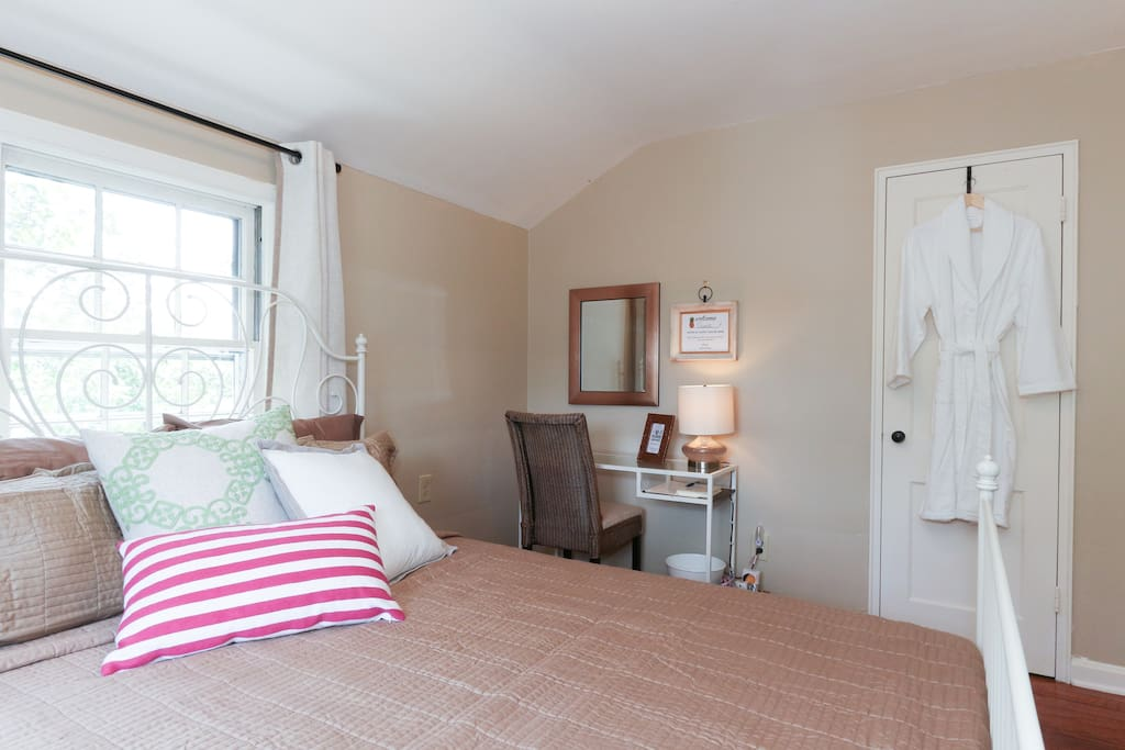 Our cozy guest room, equipped with extra pillows, blankets, a robe, and amenities you expect at a B&B.