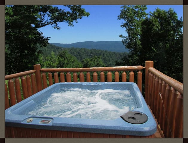 Relax in the hot tub and soak in the views!