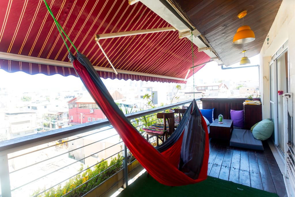 The colorfull balcony with a hammock you can chill on