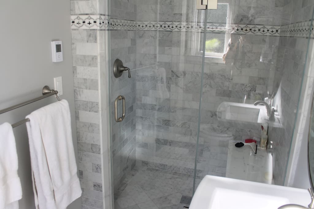 Newly remodeled bathroom with large shower, marble tile and heated floors.