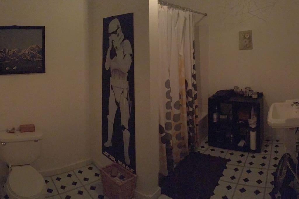 Shared bathroom next to bedroom door.