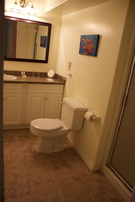 A clean and spacious bathroom for washing your cares away.