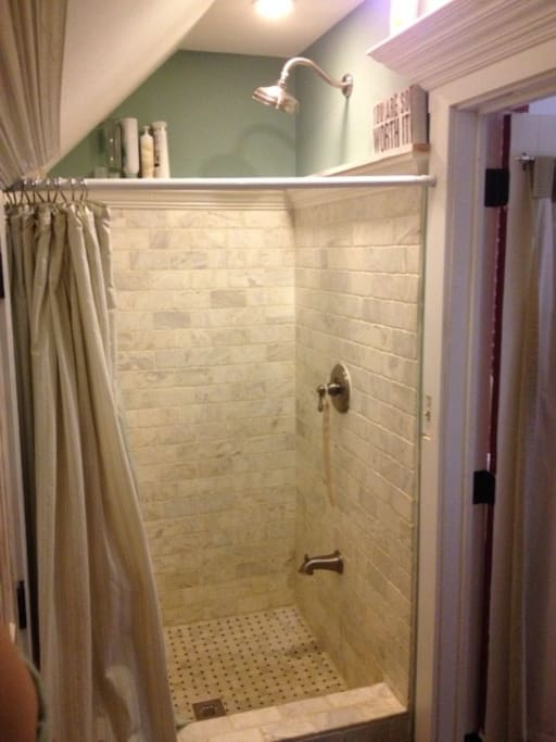 Carerra marble tile shower
