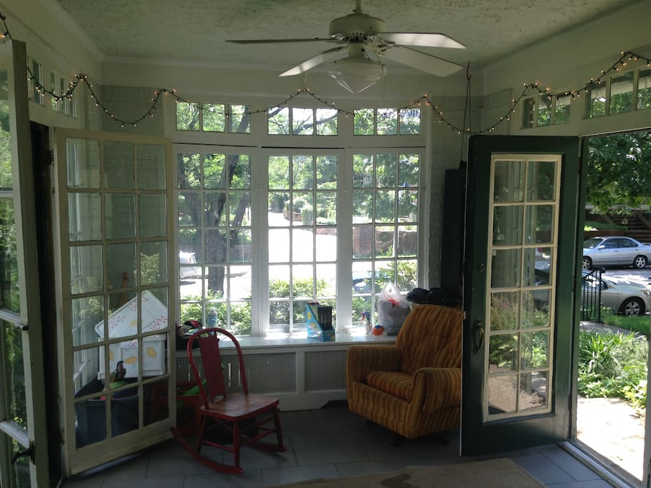 Sunny porch for sitting, storing shoes, coats etc.
