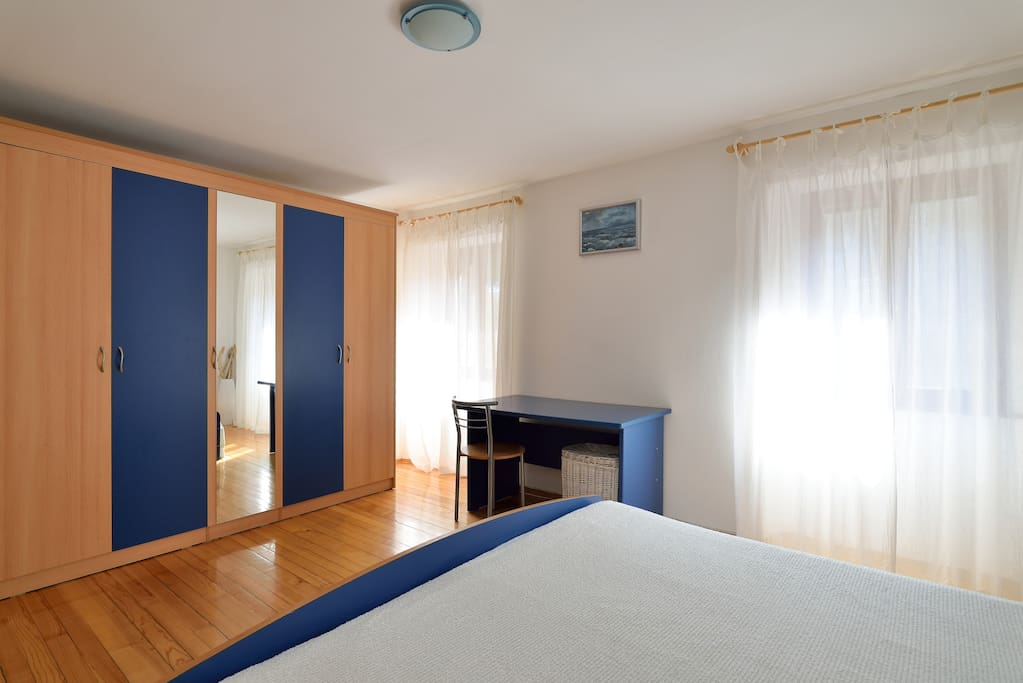 Master bedroom with two windows - lot of sun but also very good shutters