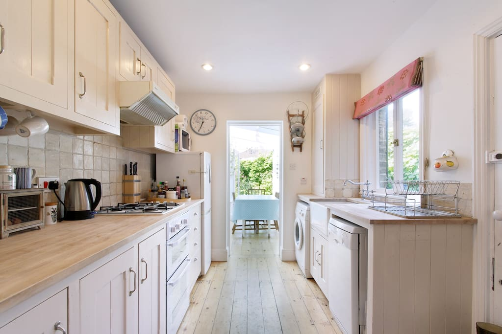 Kitchen leading to conservatory and garden