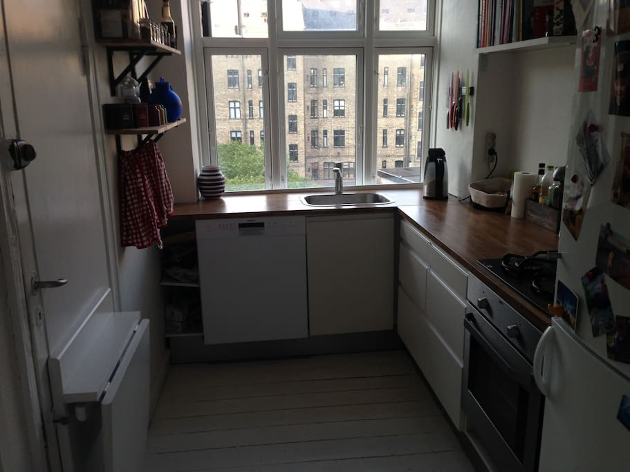 Functional kitchen with dishwasher and access to the outside private backyard
